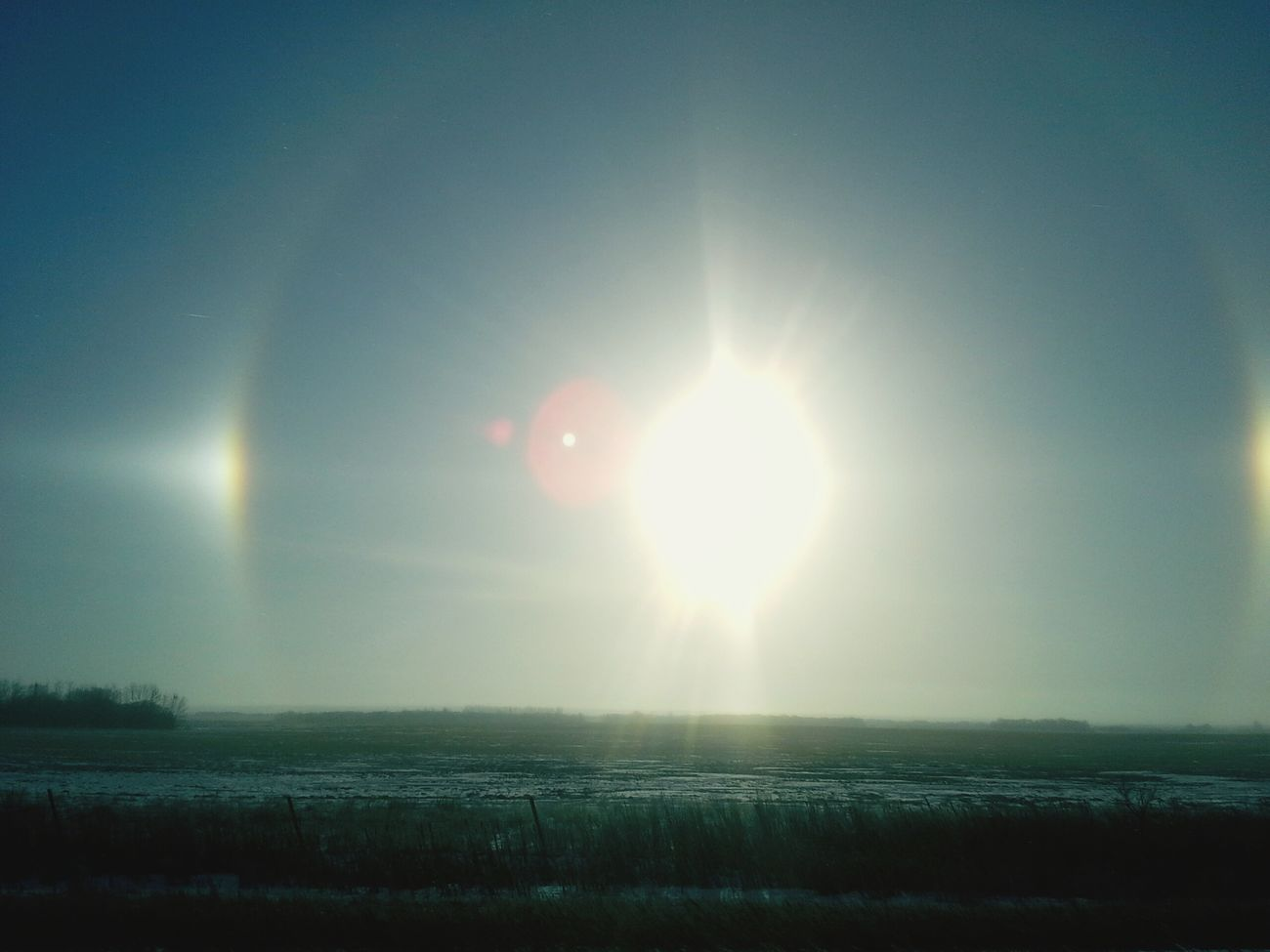 """This was taken on our way into the city of Warman , Saskatchewan , Canada . Look wt these beautiful """"SUN DAWGS """"!!"""