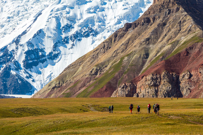 Hiking Kyrgyzstan Pamir Mountains Trekking Beauty In Nature Day Grass Hiking Landscape Leisure Activity Lifestyles Men Mountain Mountain Range Nature Outdoors Pamir People Real People Scenics Sky Snow Snowcapped Mountain Travel Destinations Women
