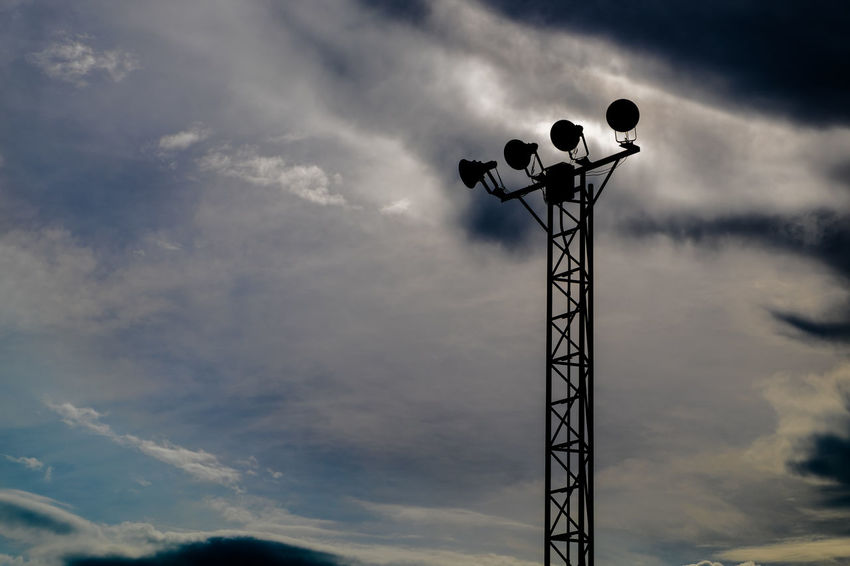 Silhouette of stand alone spotlight pole was closed with cloudy dark blue sky background. Cloudy High Lonely Architecture Cloud - Sky Dark Tones Day Low Angle View Nature No People Outdoors Pole Sillouette Sky Spotlight Bucharest 2016 Steel Structure Under Exposure