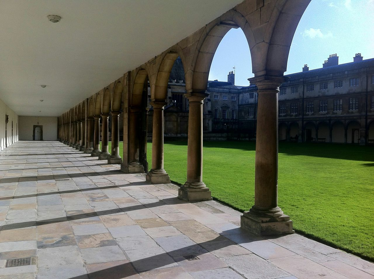 Cambridge Trinity College Cloister Archs Architecture Green No People Corridor Perspective Arches Columns Light And Shadow Empty Corridor Stone Floor Stone Material Cambridge University University Campus Repetition Quiet Quiet Places