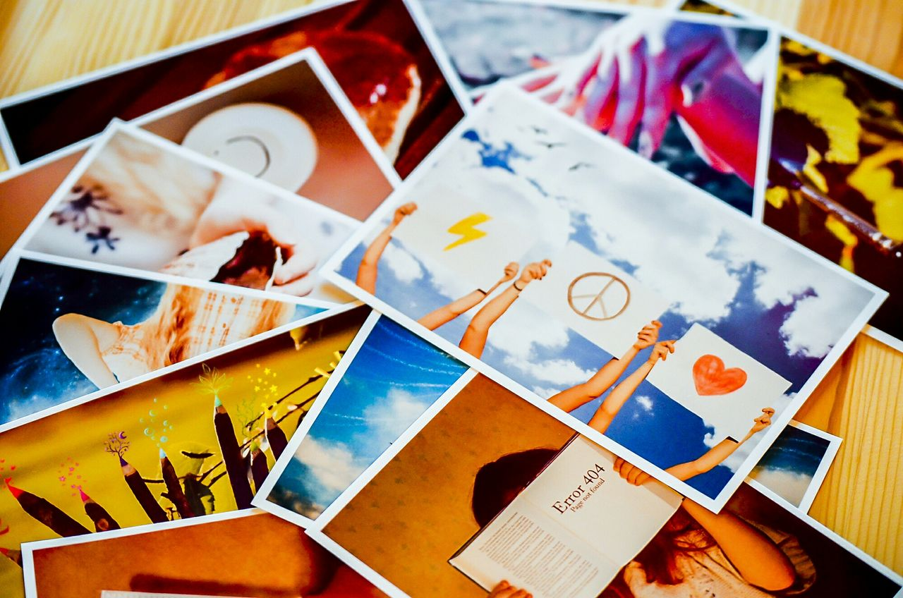 High Angle View Of Photographs On Table