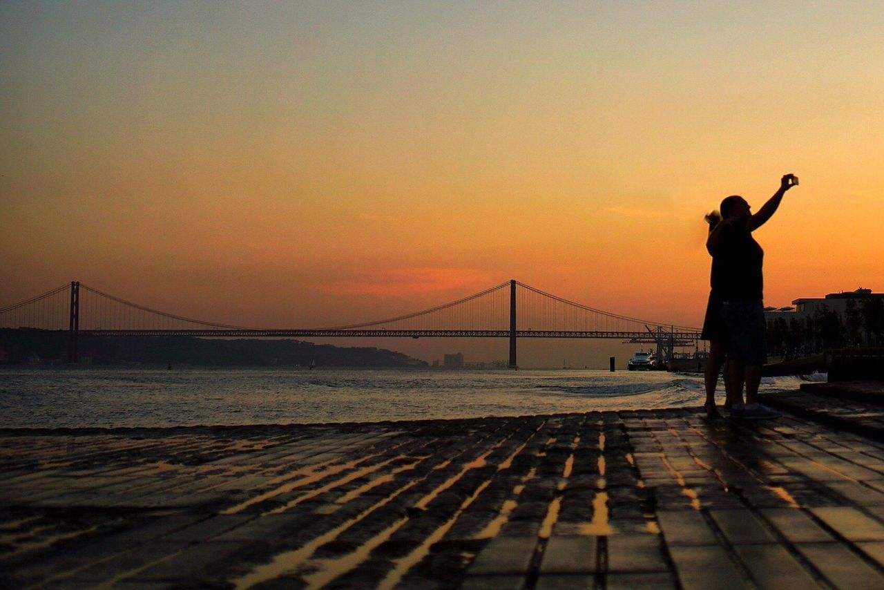 Lisbon Lisboa Lifestyles City Life City Cityscape Sunset Water Colors Sky Holiday Silhouette Couple Self Portrait Travel Nature Horizon Over Water Promenade People Real People Sky And Clouds Portugal Travel Destinations Urban Skyline