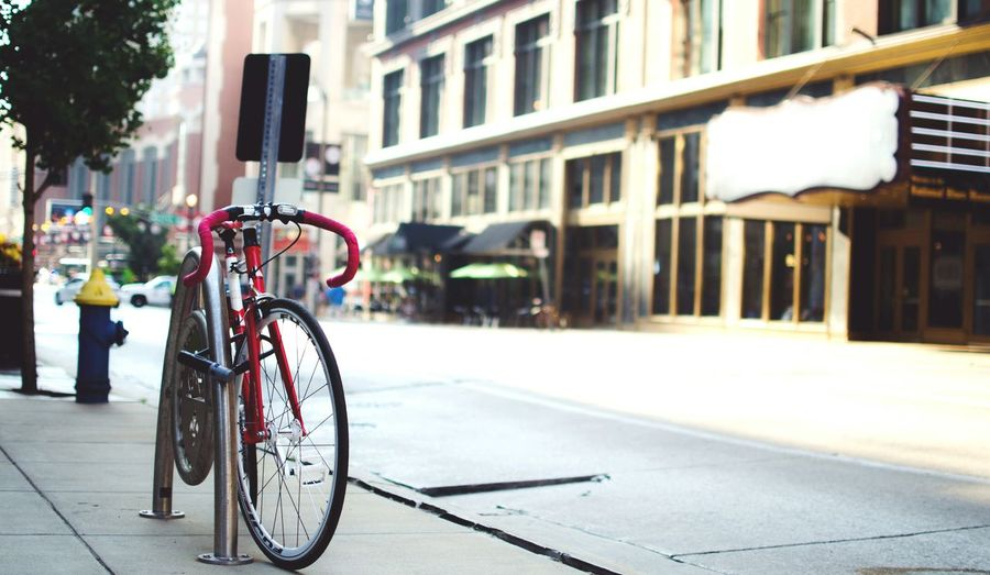 Red Wheelies in town Bicycle Cityscape in Downtown St.Louis Missuori Streetphotography