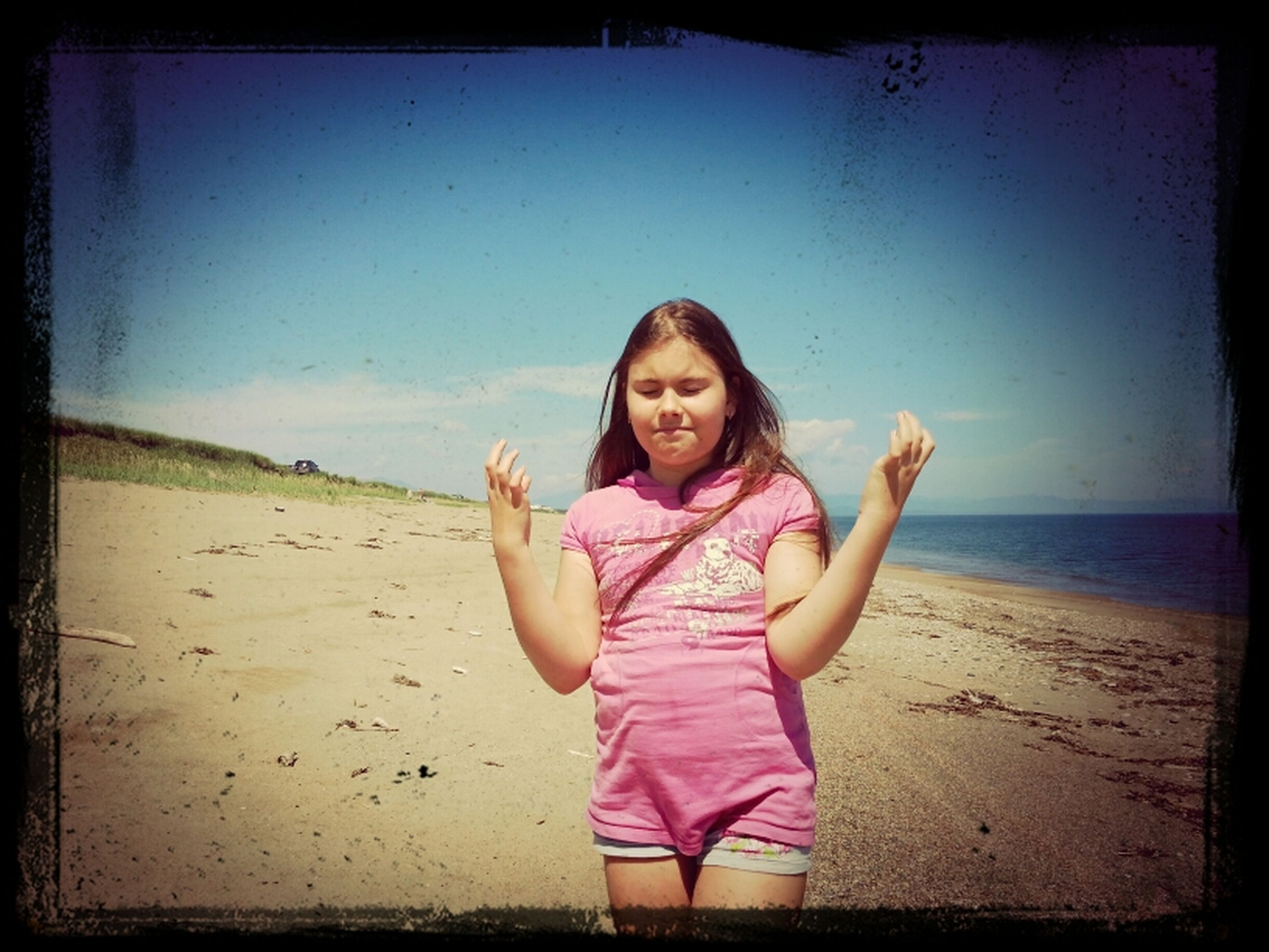 transfer print, beach, auto post production filter, sea, lifestyles, sand, leisure activity, shore, person, horizon over water, childhood, casual clothing, water, full length, elementary age, sky, girls, standing