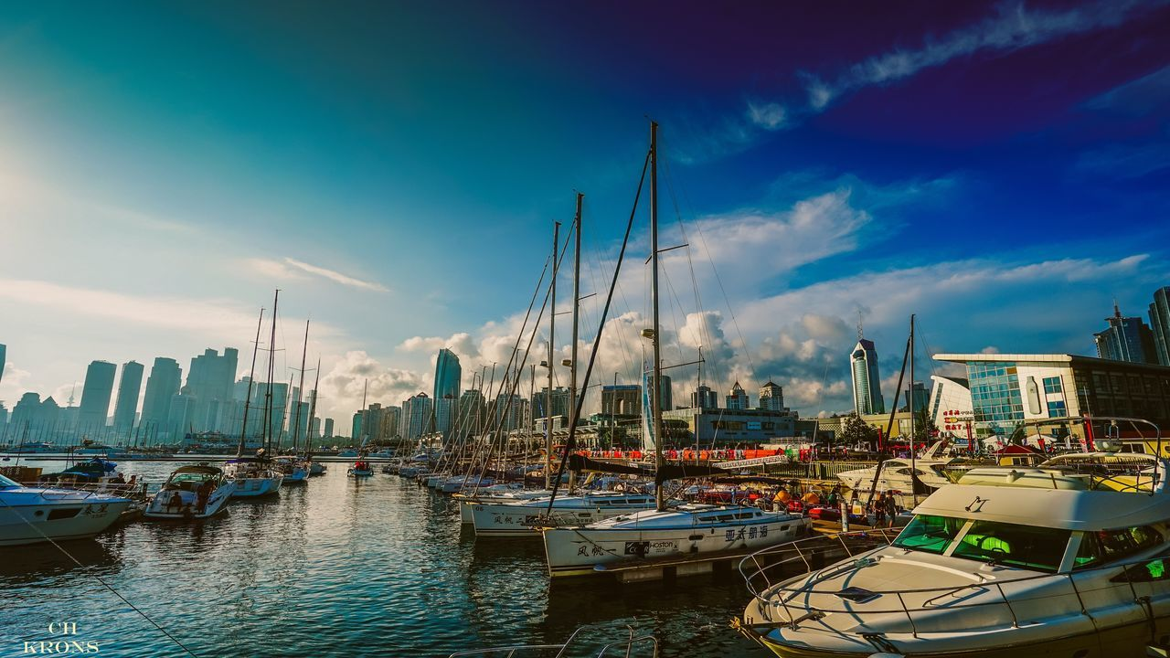 nautical vessel, moored, mode of transport, transportation, boat, harbor, sky, water, architecture, building exterior, built structure, marina, no people, cloud - sky, outdoors, mast, yacht, sea, sailboat, travel destinations, city, day, nature