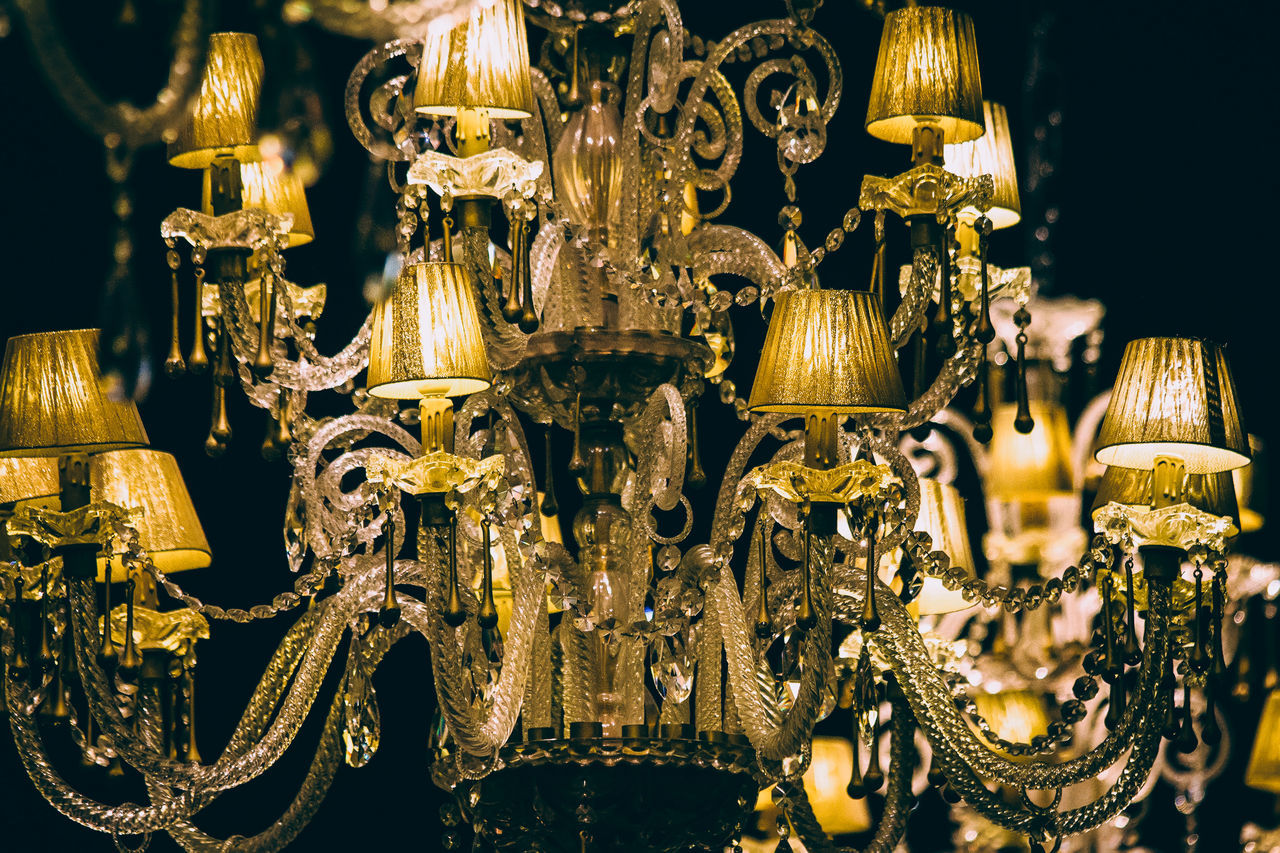 hanging, for sale, no people, ornate, retail, large group of objects, close-up, illuminated, luxury, elegance, gold colored, variation, crystal, market, night, indoors