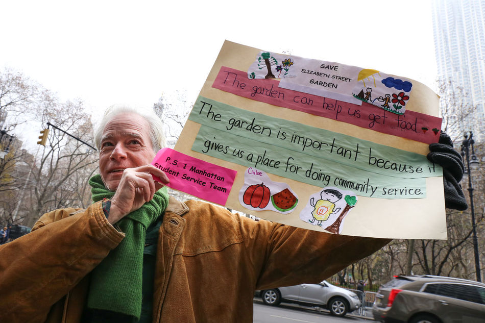 With the tension between housing development and open space, community members from the Little Italy neighborhood (and also lower east side and greenwich village) protest outside the office of Council Member Margaret Chin, who is advocating for housing on the site of the Elizabeth Street Garden in Little Italy. Little Piece Of Heaven Protest Activism Art City Life Community In Down Elizabeth Street Garden Lower Manhattan New York City Save The Garden Urban Gardens