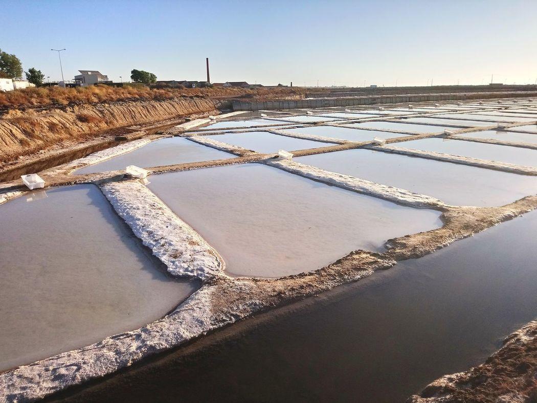 Salt - Mineral Water Salt Flat Landscape No People Tavira, Portugal Backgrounds Clear Sky Full Frame