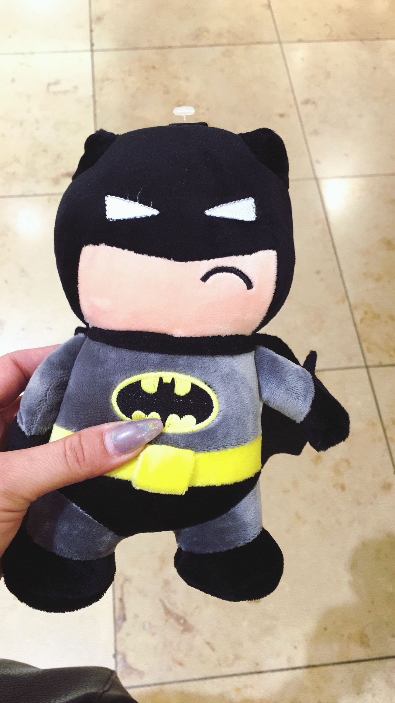 Human Hand Real People One Person Human Body Part Human Finger Holding Lifestyles Leisure Activity Day Outdoors Men Women Low Section Close-up People Batman Toy