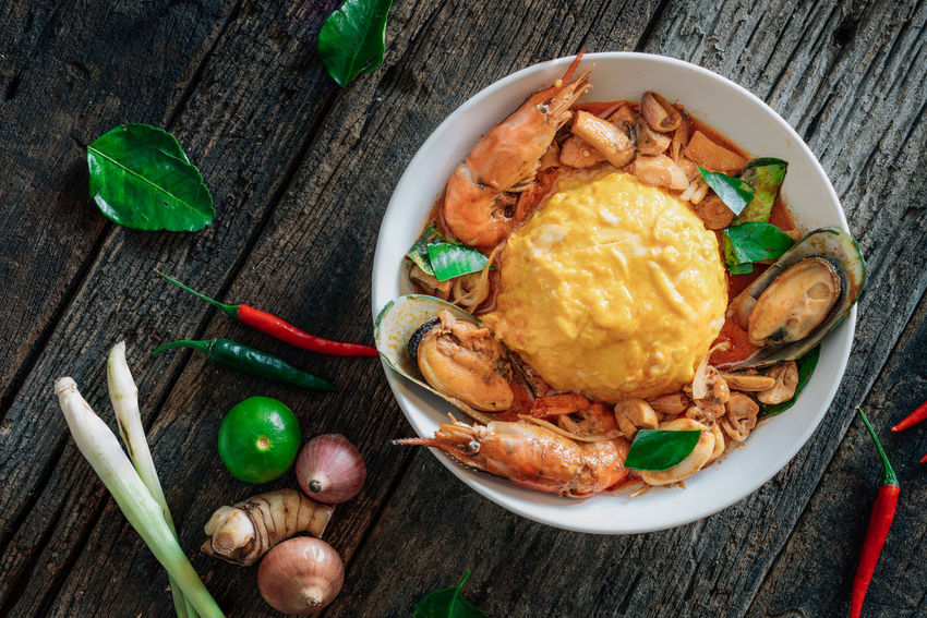 """Rice and scrambled eggs topped with """"Tom Yum Seafood"""" sauce Asian Food Bowl Chili  Cuisine Eggs Food Lemon Red Seafoods Shrimp Thai Food Market Reviewers' Top Picks"""