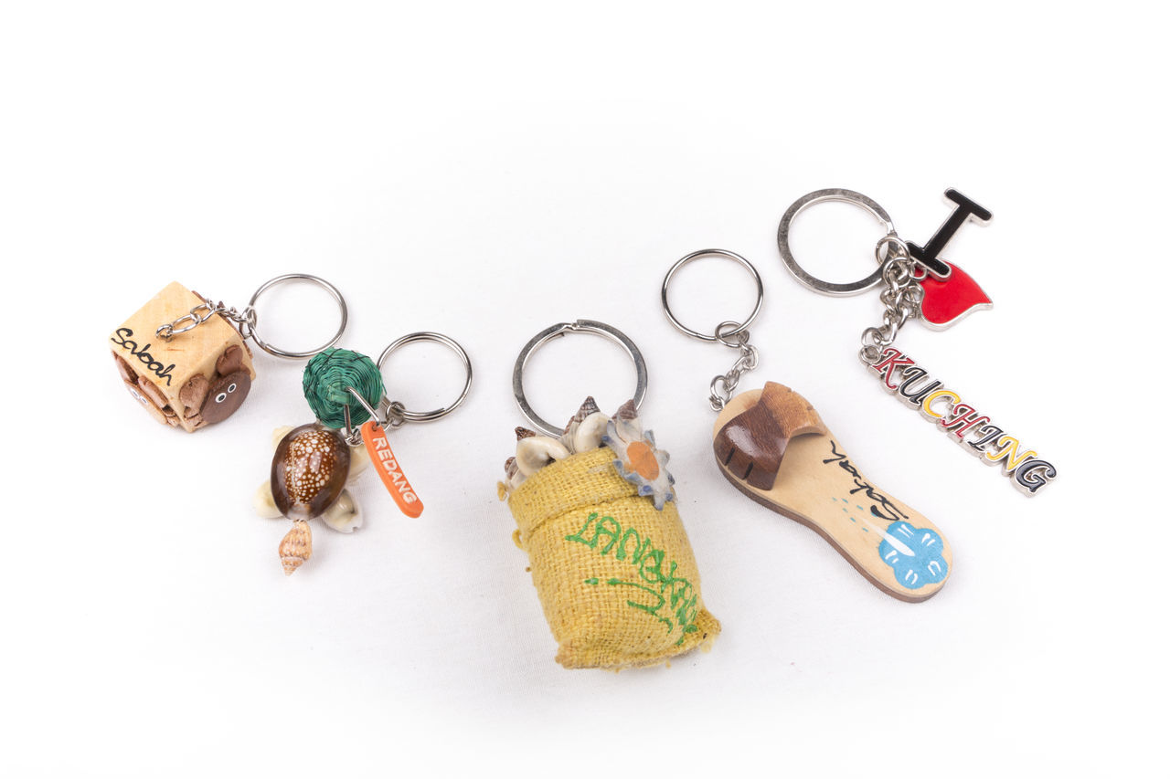 Various souvenir key chains from Malaysia tourism sites on a white background ASIA Attraction Collection Flat Lay Island Key Chain Kuching Langkawi Malaysia Malaysia Truly Asia Redang Island Sabah Sarawak Tour Tourism Travel White Background