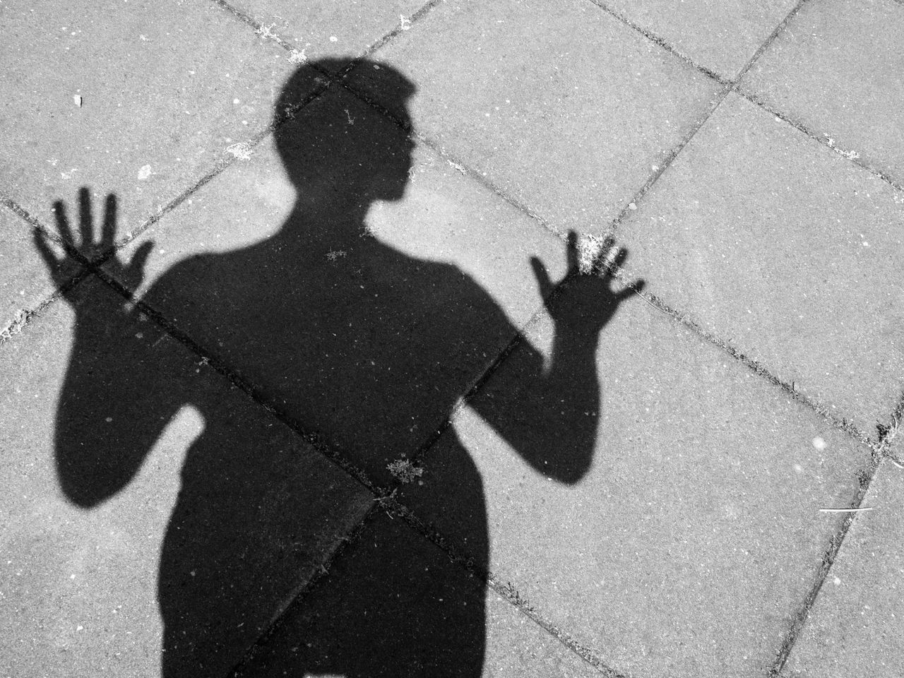 Black And White Childhood Day Focus On Shadow Gesturing High Angle View Human Hand Leisure Activity Lifestyles Men One Person Outdoors People Real People Self Portrait Shadow Streetphotography Sunlight Textures The Street Photographer - 2017 EyeEm Awards Tiles