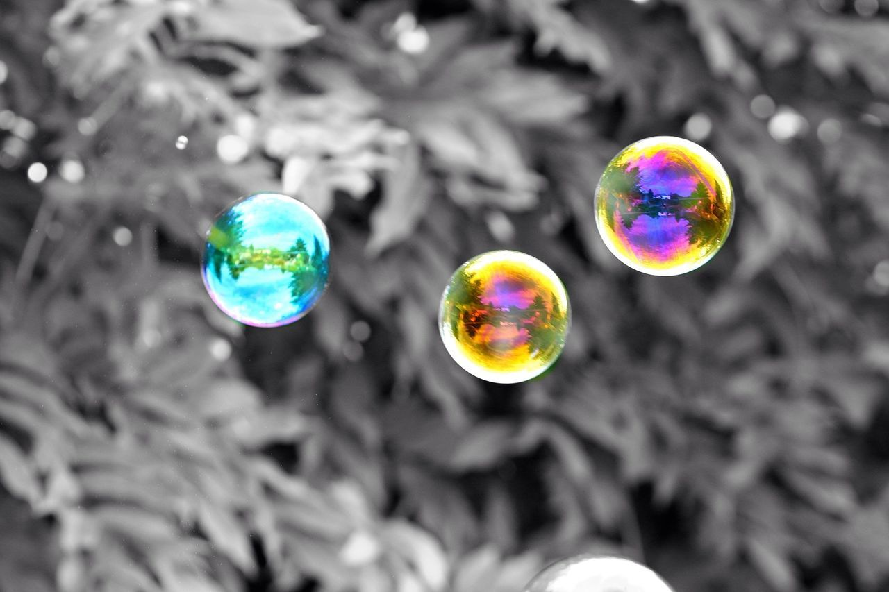 bubble, bubble wand, multi colored, fragility, rainbow, spectrum, mid-air, no people, outdoors, day, close-up