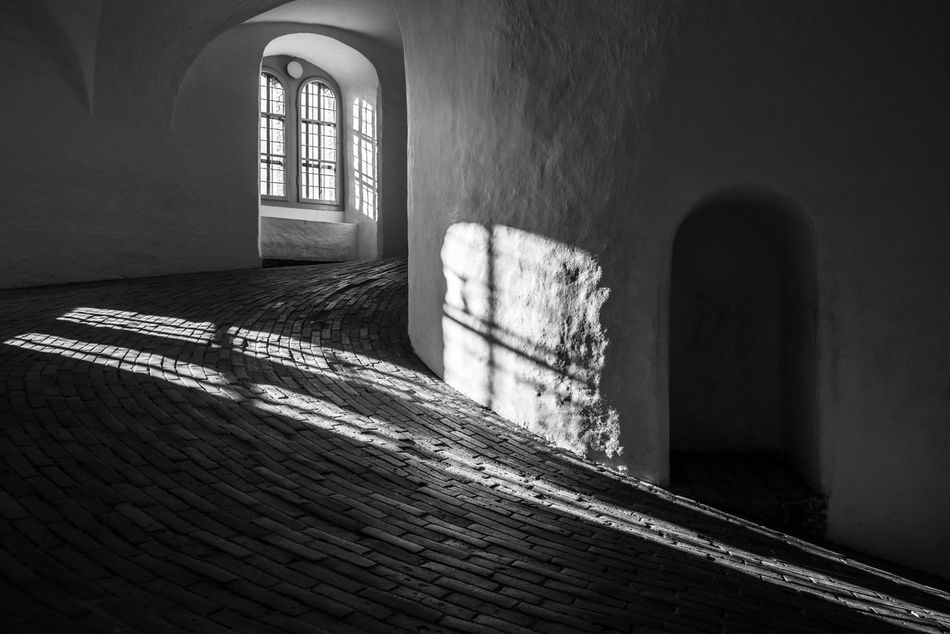 Catching some rays Architecture B&w Blackandwhite Built Structure Capital Cities  City Copenhagen Denmark Indoors  Mono Monochrome No People Nordic Countries Old Old Buildings Old-fashioned Round Tower Scandinavia Sunlight Sunlight And Shadow Tower Window