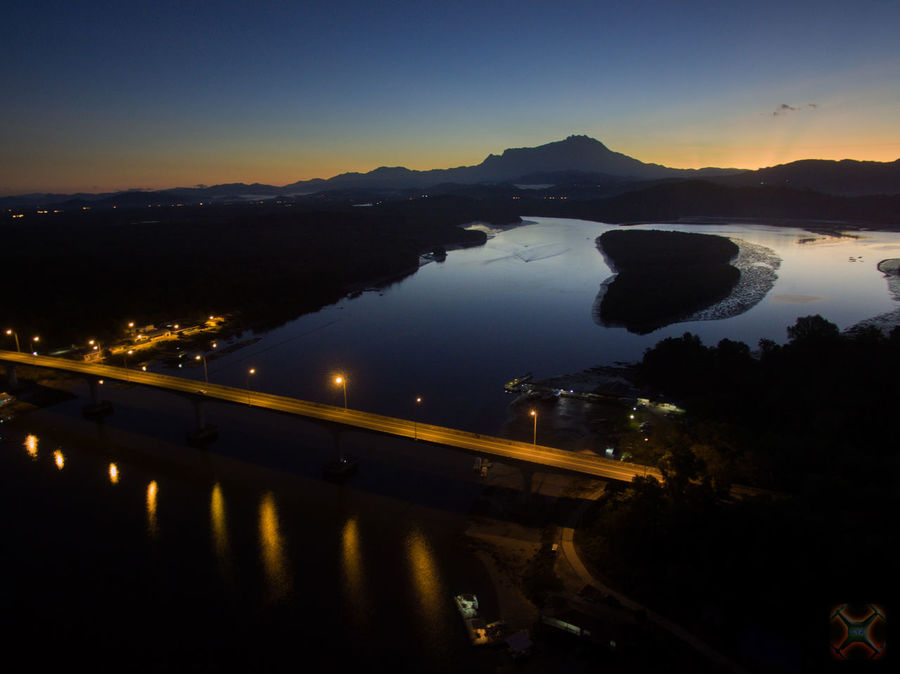 Sunrise view of Mount Kinabalu from Mengkabong Bridge, Sabah, Malaysia. Architecture Beauty In Nature City Illuminated Mengkabong River Mountain Nature Night No People Outdoors Reflection Sabah Scenics Silhouette Sky Sunset Tree Tuaran Water