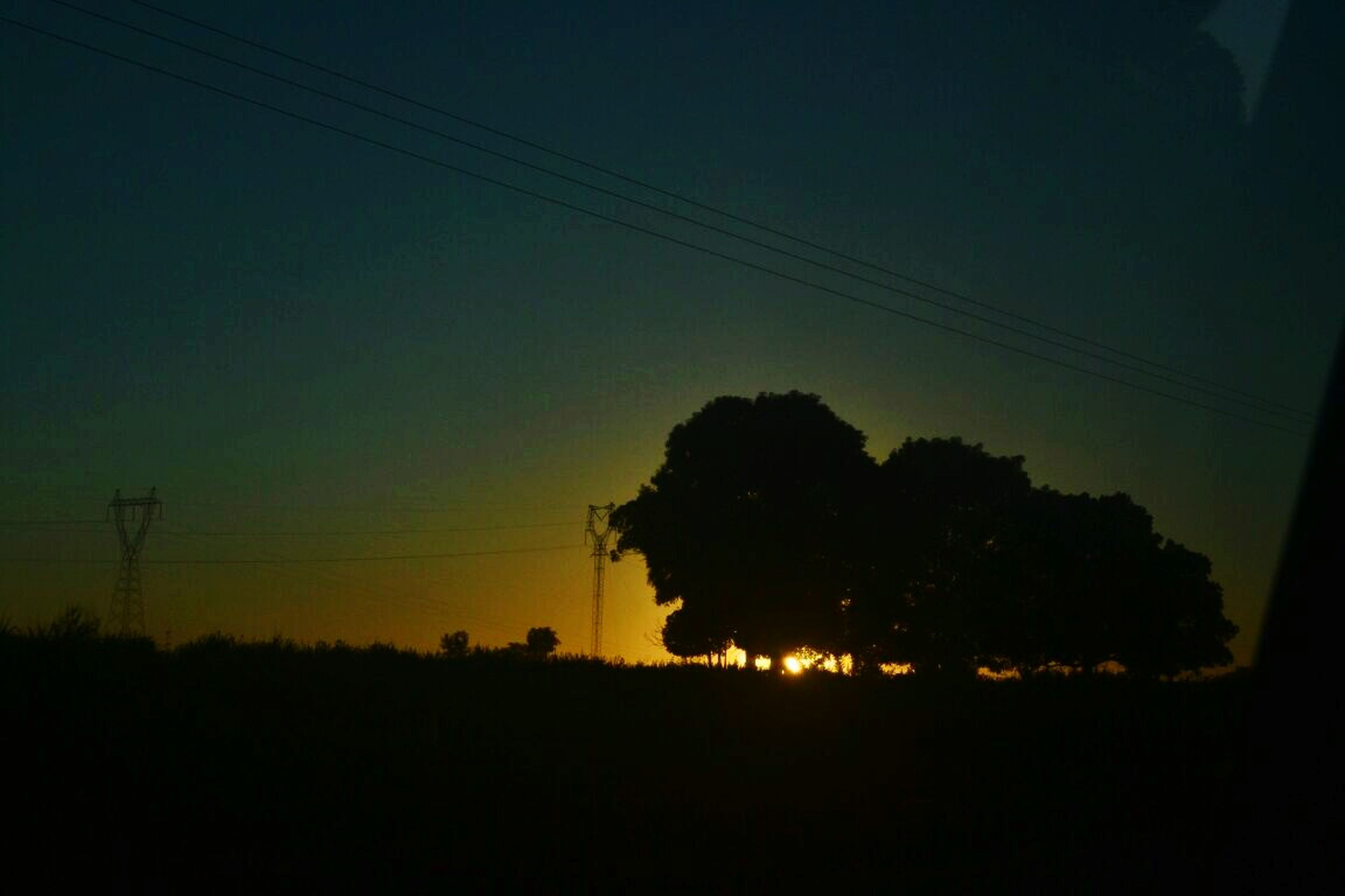 silhouette, power line, electricity pylon, electricity, power supply, tree, sunset, tranquility, tranquil scene, sky, cable, landscape, scenics, nature, beauty in nature, dark, dusk, copy space, connection, field