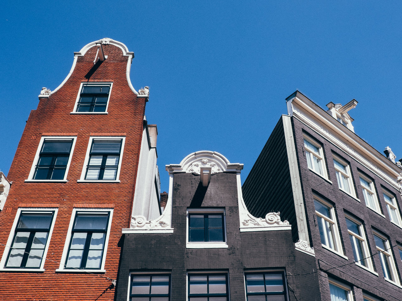 Amsterdam Architecture Blue Building Exterior Built Structure City Clear Sky Day Low Angle View Netherlands No People Outdoors Sky Sunlight The Architect - 2017 EyeEm Awards Window