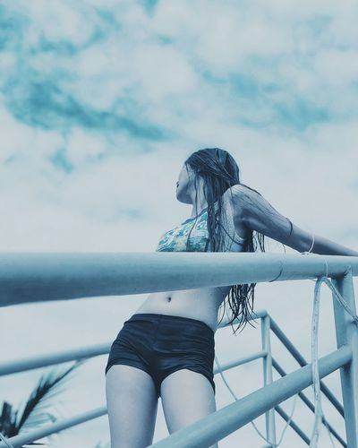 EyeEmNewHere One Person Sea Railing Adult Only Women Beauty One Woman Only Young Adult People Beautiful People Outdoors Fashion Women Summer Cloud - Sky Leisure Activity Adults Only Long Hair One Young Woman Only Vacations