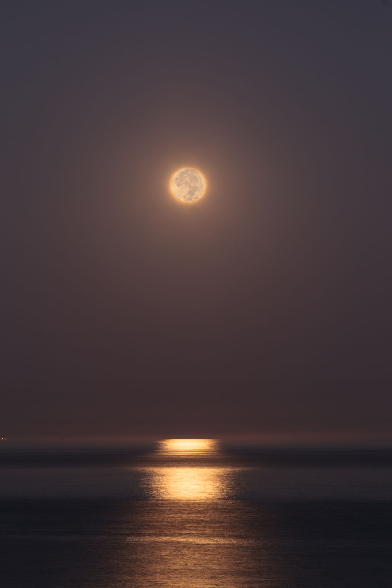 Super moon sets over the Pacific ocean in Laguna Beach, California, United States Beauty In Nature California Horizon Over Water Laguna Beach, CA Moon Moonset Nature No People Ocean Outdoors Scenics Sea Sea And Sky Sky Sunset Tranquil Scene Tranquility United States Water