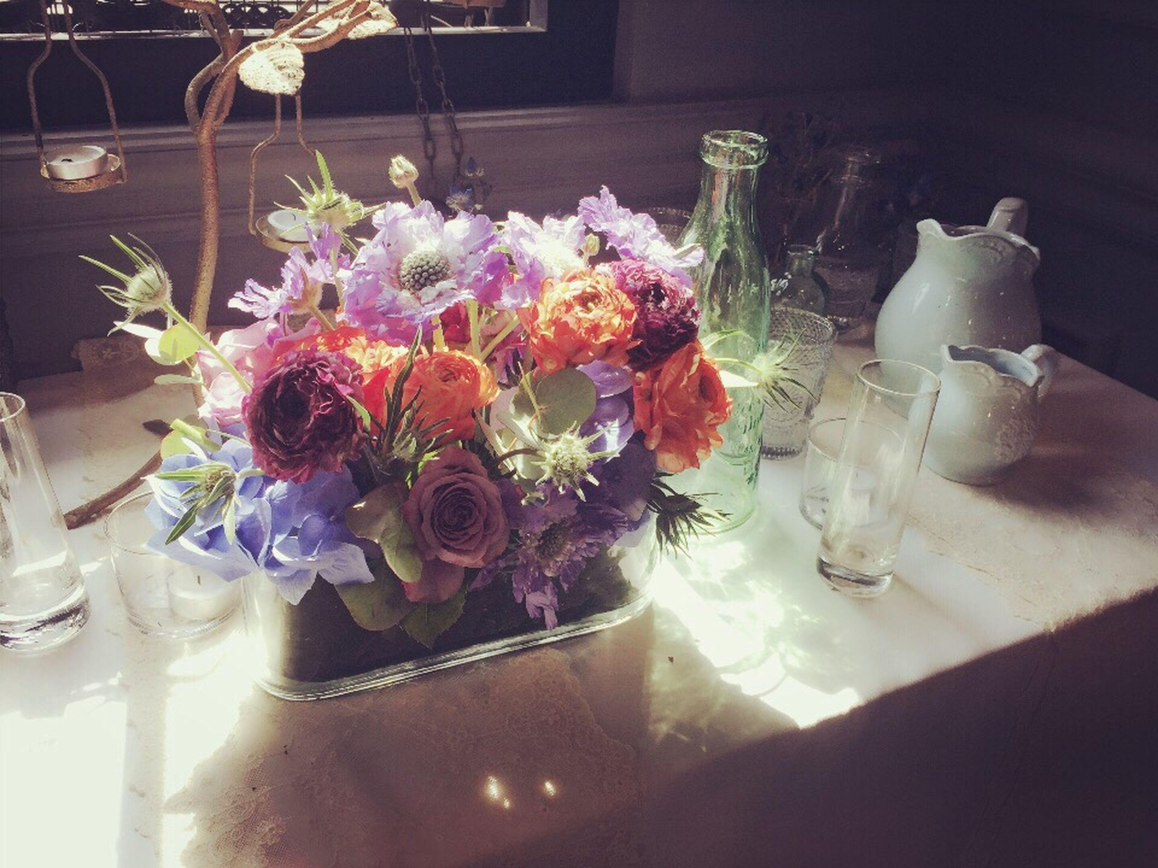 flower, indoors, vase, table, decoration, still life, freshness, variation, petal, home interior, fragility, flower arrangement, glass - material, no people, reflection, arrangement, high angle view, potted plant, flower pot, bouquet