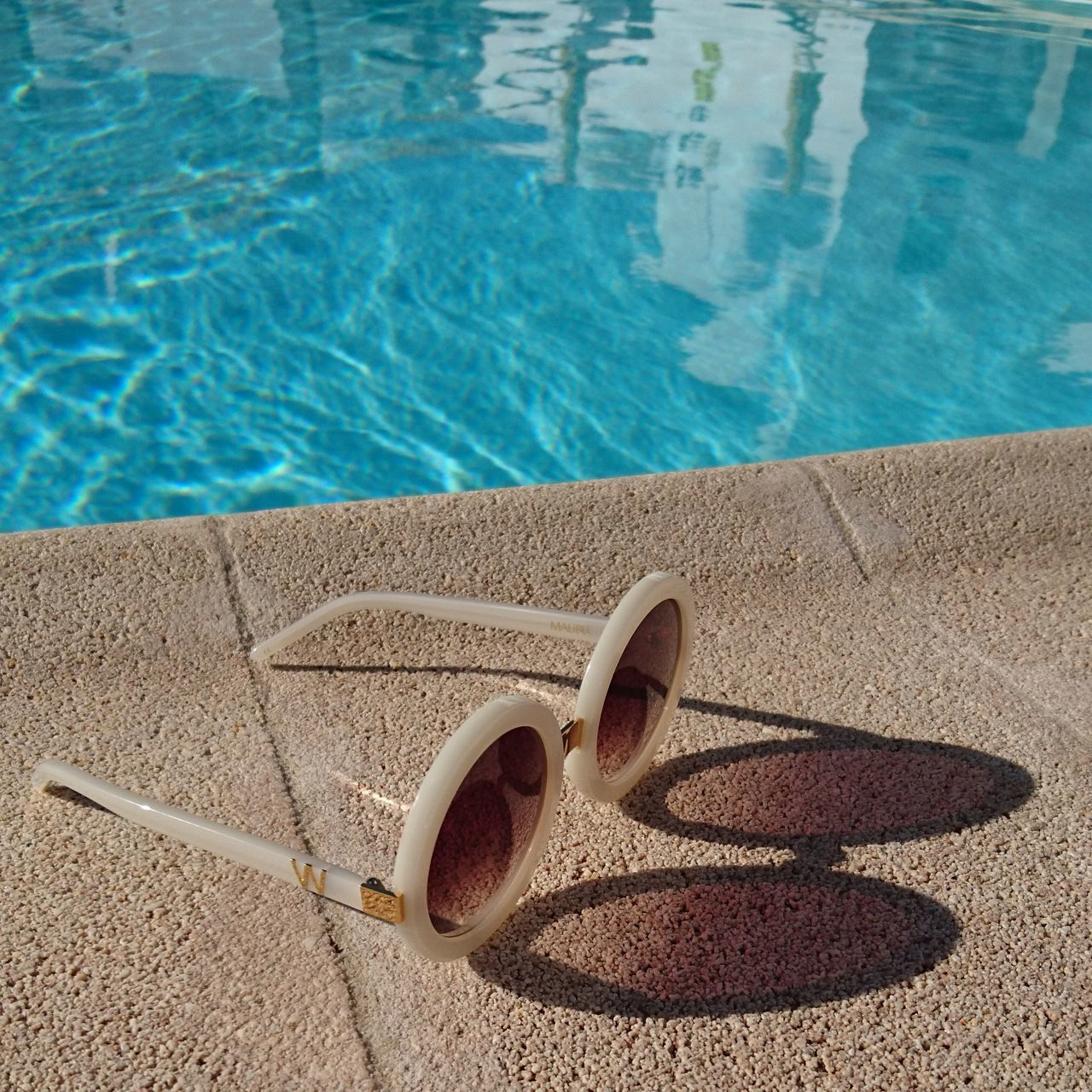 Poolside with my favorite sunglasses 😎 Poolside Swimming Pool Nofilter Wildfoxcouture Wildfox Reflection Shadow Shades Fuerteventura No People Holiday POTD Hanging Out Taking Photos Water High Angle View Day Outdoors Close-up Nature