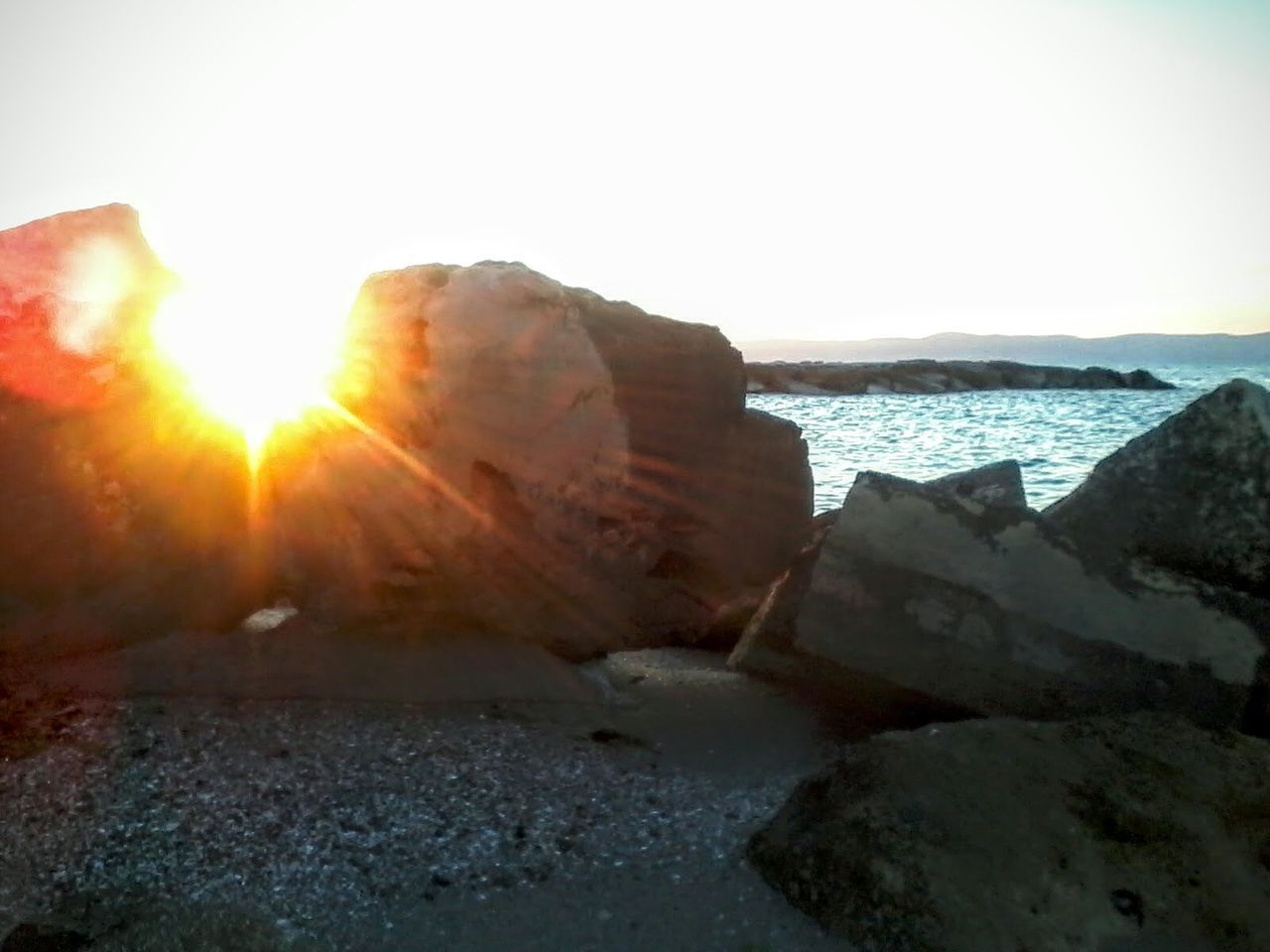 sea, nature, rock - object, no people, beach, sunlight, scenics, outdoors, sky, horizon over water, sunset, day, water, beauty in nature, close-up