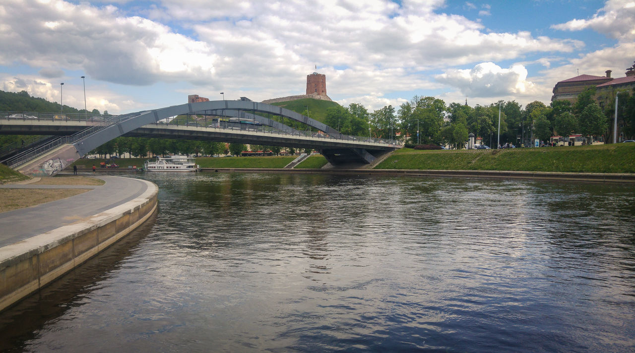 The bridge of King Mindaugas. Vilnius, Lithuania. Architecture Bridge - Man Made Structure Building Exterior Built Structure City Cloud - Sky Day Neris Outdoors Reflection Sky Travel Destinations Tree Vilnius Vilnius City Vilnius, Lithuania Water