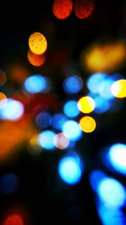 Illuminated Night Defocused Spotted Lighting Equipment Vibrant Color Nightlife No People Light Effect Multi Colored Close-up Outdoors Xmas Lights  Xmas Decorations Bokeh Photography Bokeh Decorative Lights Decorative Art Spotted Black Background Concentric Abstract