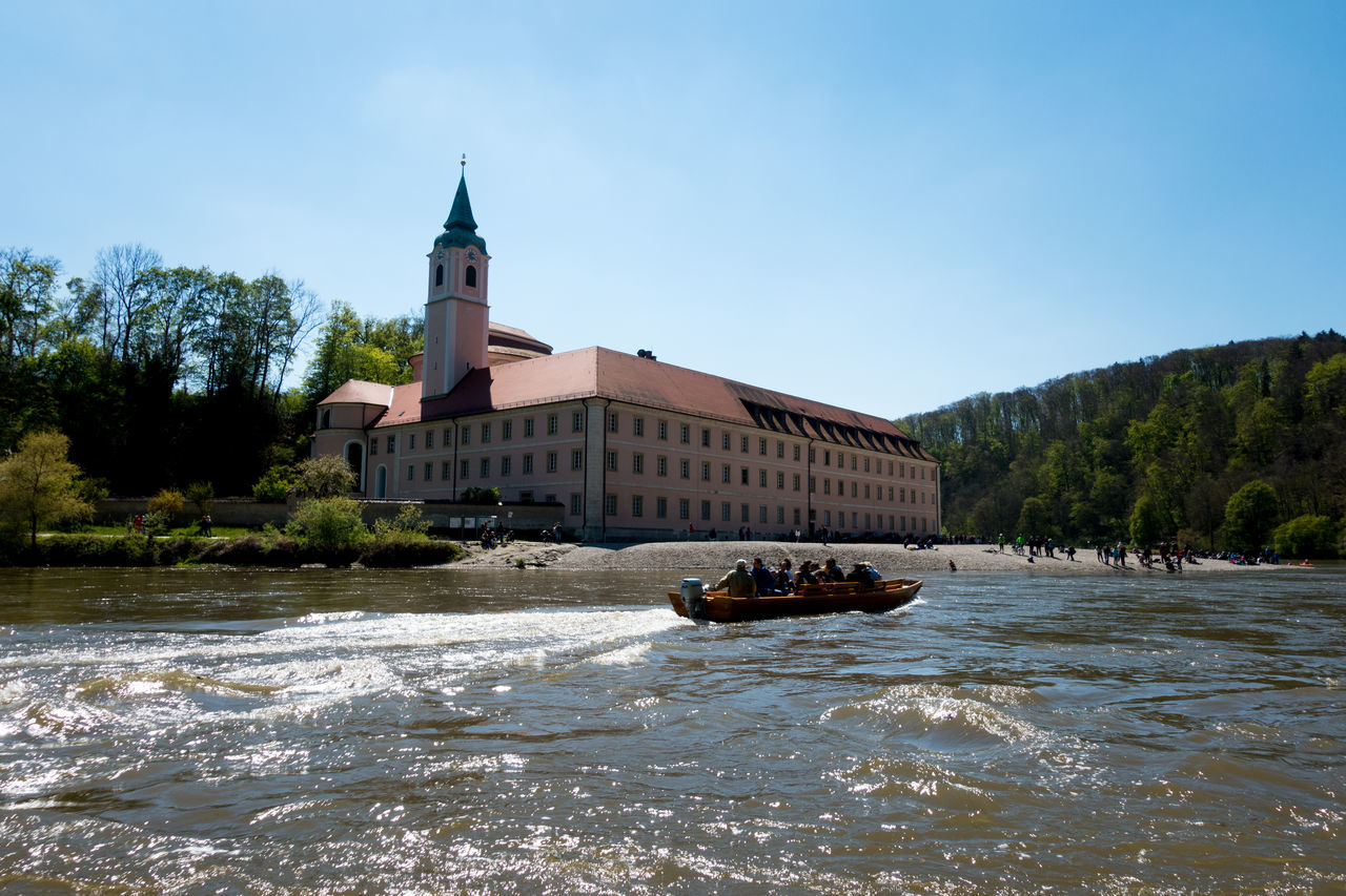 A Little boat brings tourists to monastery of Weltenburg. Architecture Bavaria Bayen Building Exterior Built Structure Clear Sky Day Donau Monastery Of Weltenburg Nature Nautical Vessel No People Outdoors Place Of Worship Reisen Religion River Sky Transportation Travel Travel Destinations Tree Water Waterfront Weltenburg
