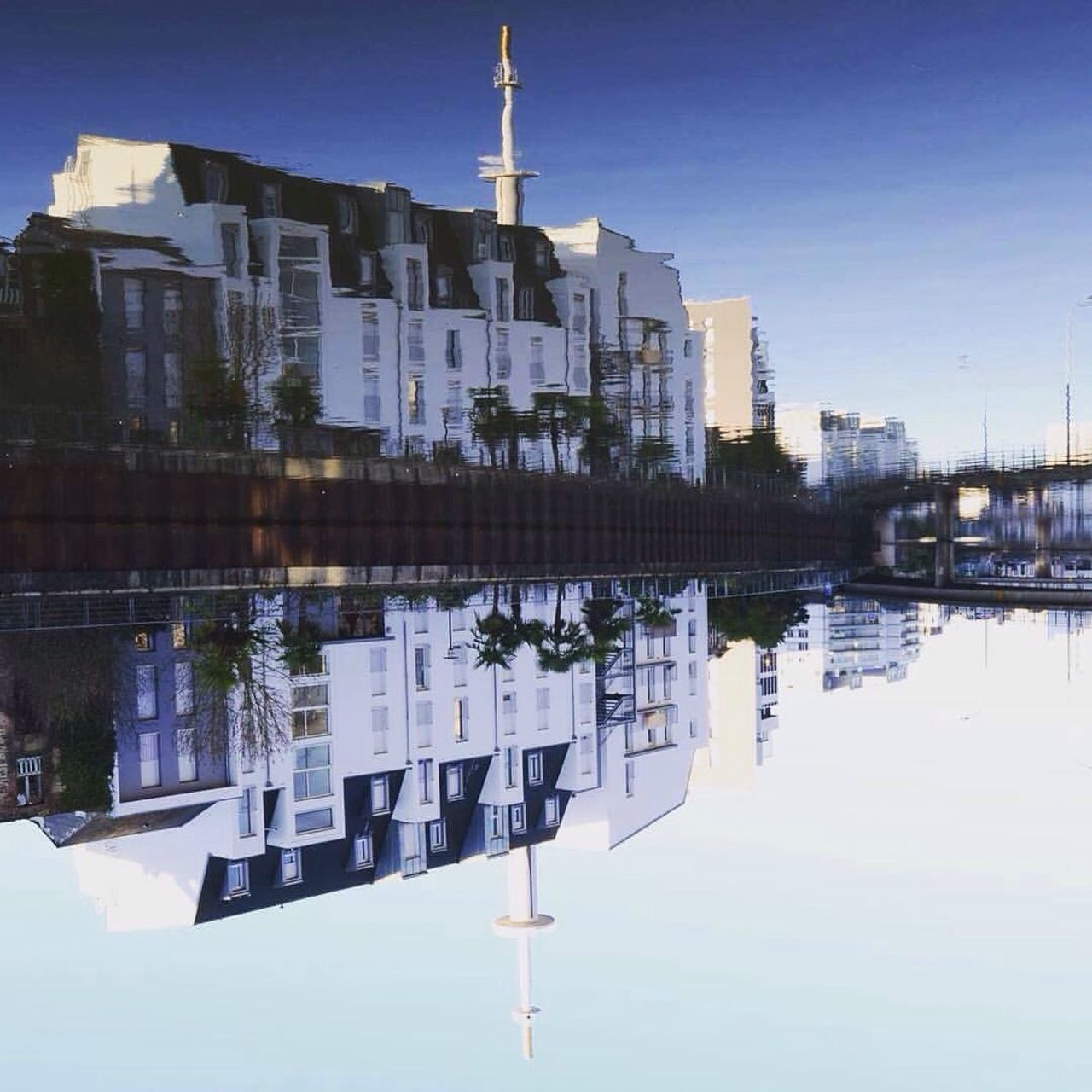 reflection, architecture, water, building exterior, built structure, outdoors, waterfront, clear sky, no people, day, sky, nature, city