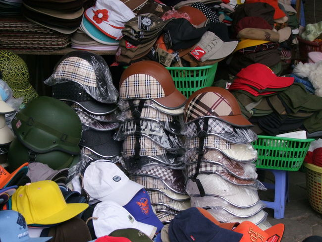 Motorbike Helmets & Hats Galore! Abundance Arrangement Casual Clothing Choice Clothing Colourful Composition Culture For Sale Full Frame Hanoi Hats In A Row Large Group Of Objects Lifestyles Motorbike Helmets Multi Colored No People Outdoor Photography Outdoors Retail  Shop Side By Side Variation Vietnam