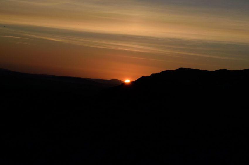 Beauty In Nature Landscape Mountain Nature No People Orange Sky Outdoors Scenics Silhouette Sky Sun Sunset