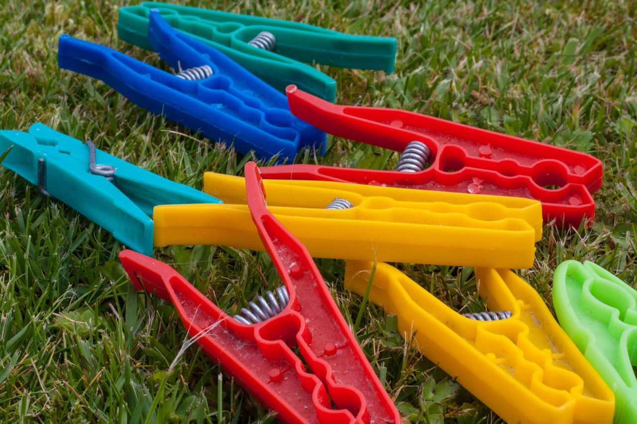Abundance Blue Close-up Day Domestic Chores Grass Grassy Green Color Multi Colored No People Outdoors Pegs Plastic Red Washing Yellow