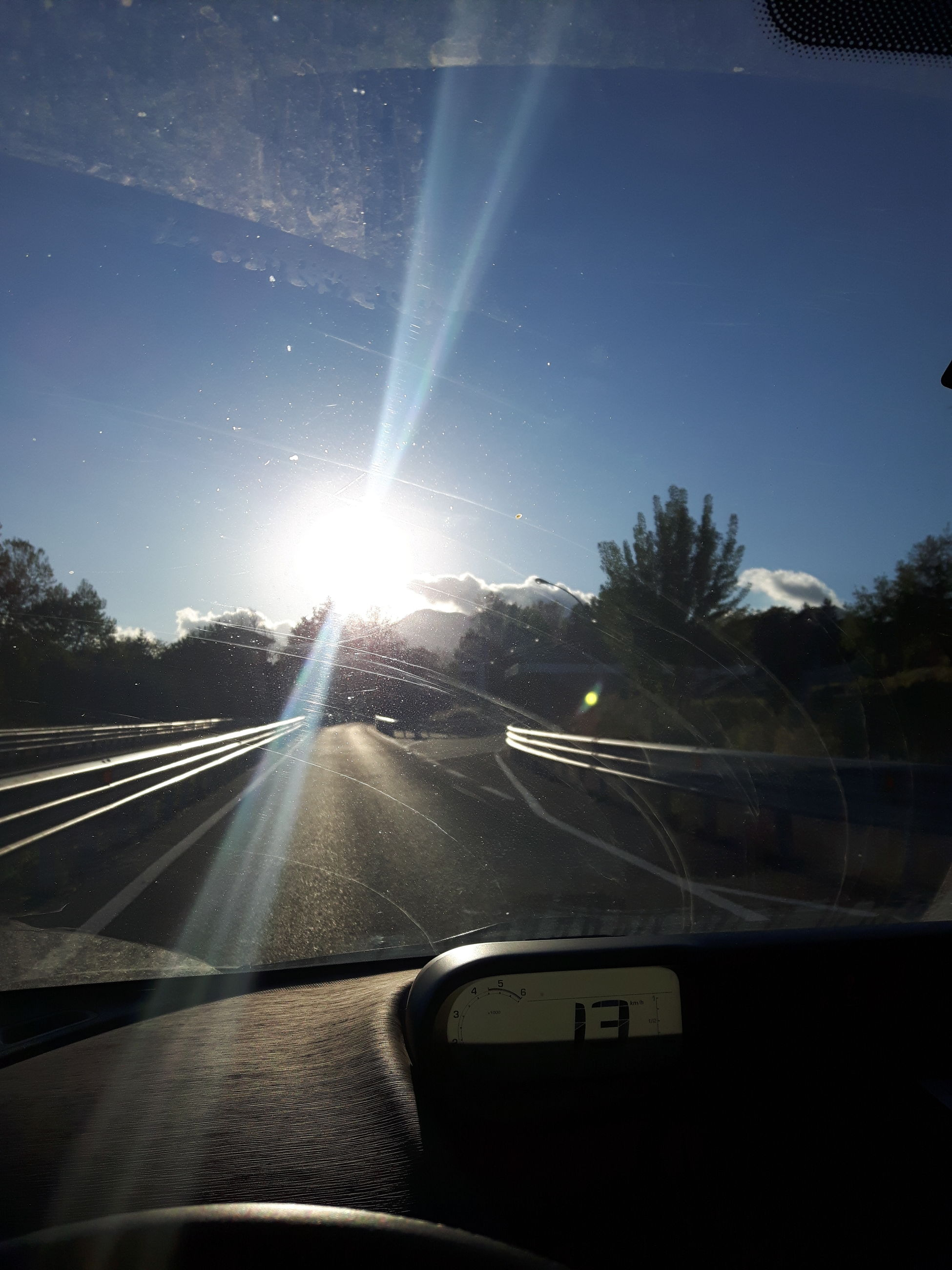 lens flare, sun, transportation, car, land vehicle, sunlight, sunbeam, mode of transport, windshield, car interior, road, sky, road trip, car point of view, no people, nature, day, tree, outdoors, beauty in nature, close-up