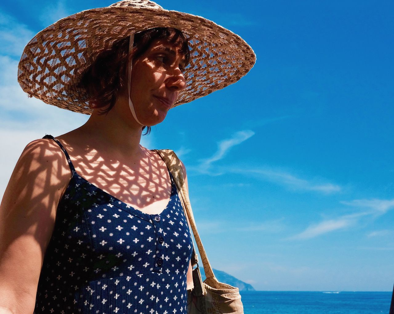 Sun patterns. Hat Sun Hat One Person Straw Hat Sky Outdoors Mid Adult Mid Adult Women Leisure Activity Lifestyles Real People Blue Young Adult Young Women Nature Day Casual Clothing Standing Sea Vacations Live For The Story Place Of Heart The Street Photographer - 2017 EyeEm Awards The Portraitist - 2017 EyeEm Awards