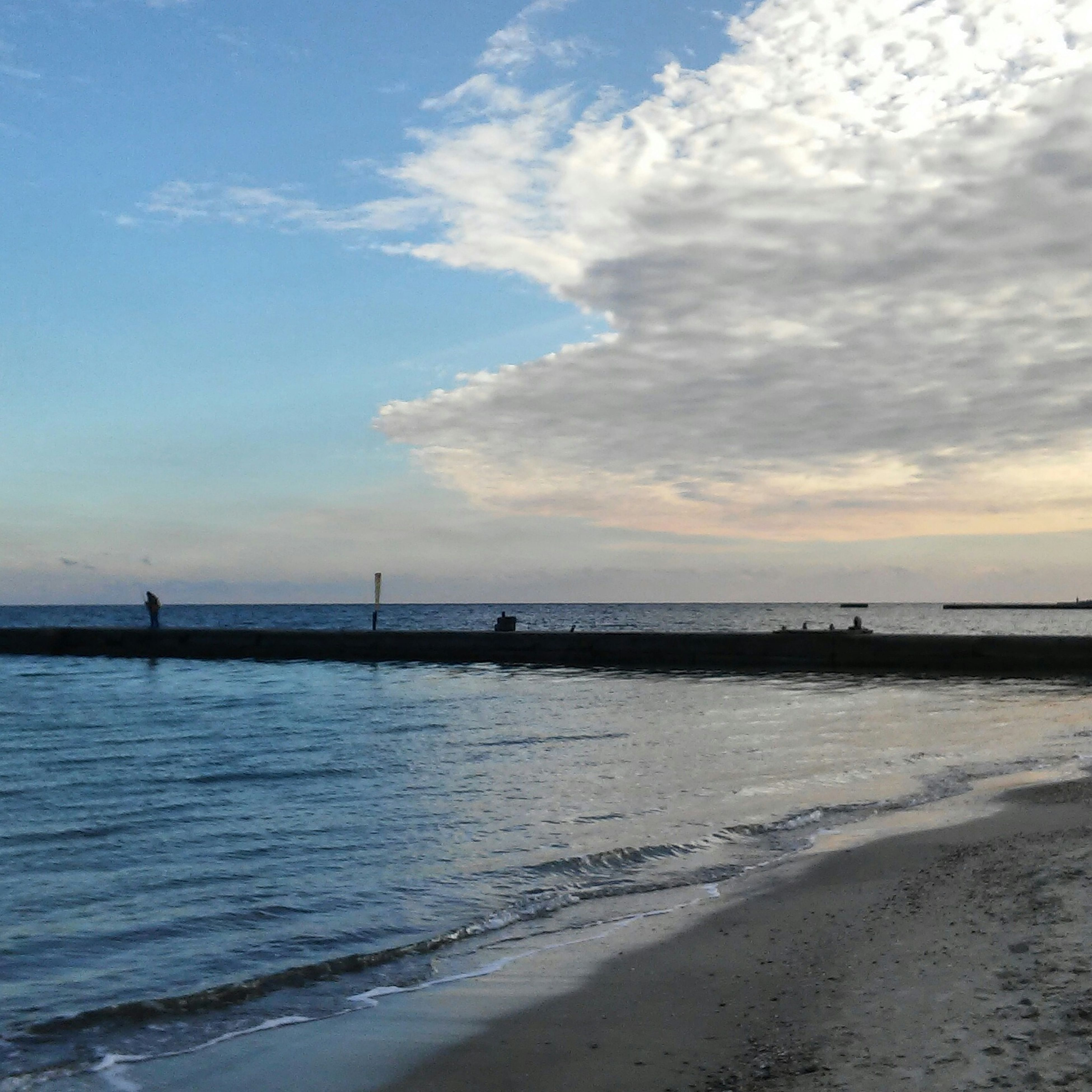 water, sea, sky, tranquil scene, tranquility, scenics, beach, beauty in nature, cloud - sky, horizon over water, nature, shore, cloud, sunset, idyllic, pier, silhouette, cloudy, sand, outdoors