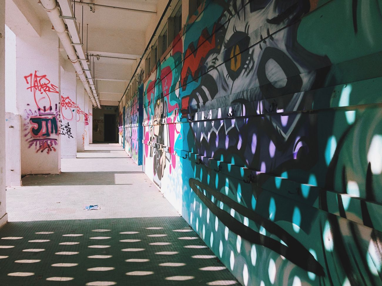 Abandoned school at Hong Kong Abandoned Architecture Check This Out Darkness And Light Day From My Point Of View Getting Inspired Graffiti Hello World HongKong In A Row Indoors  IPhoneography Iphoneonly Iphonephotography Multi Colored No People School Shadow Shadows & Lights Taking Photos Taking Pictures