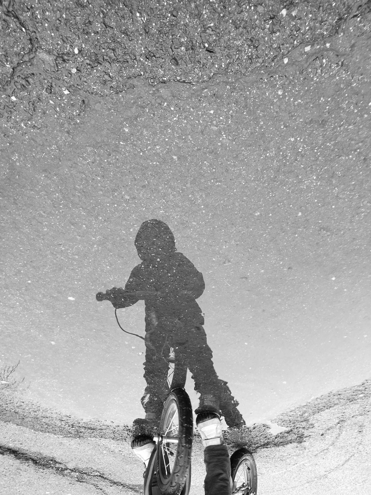 Reflection One Person Real People Concrete Floor Puddles bicycle monochrome Up Side Down Three Quarter Length Outdoors People child Day shadow