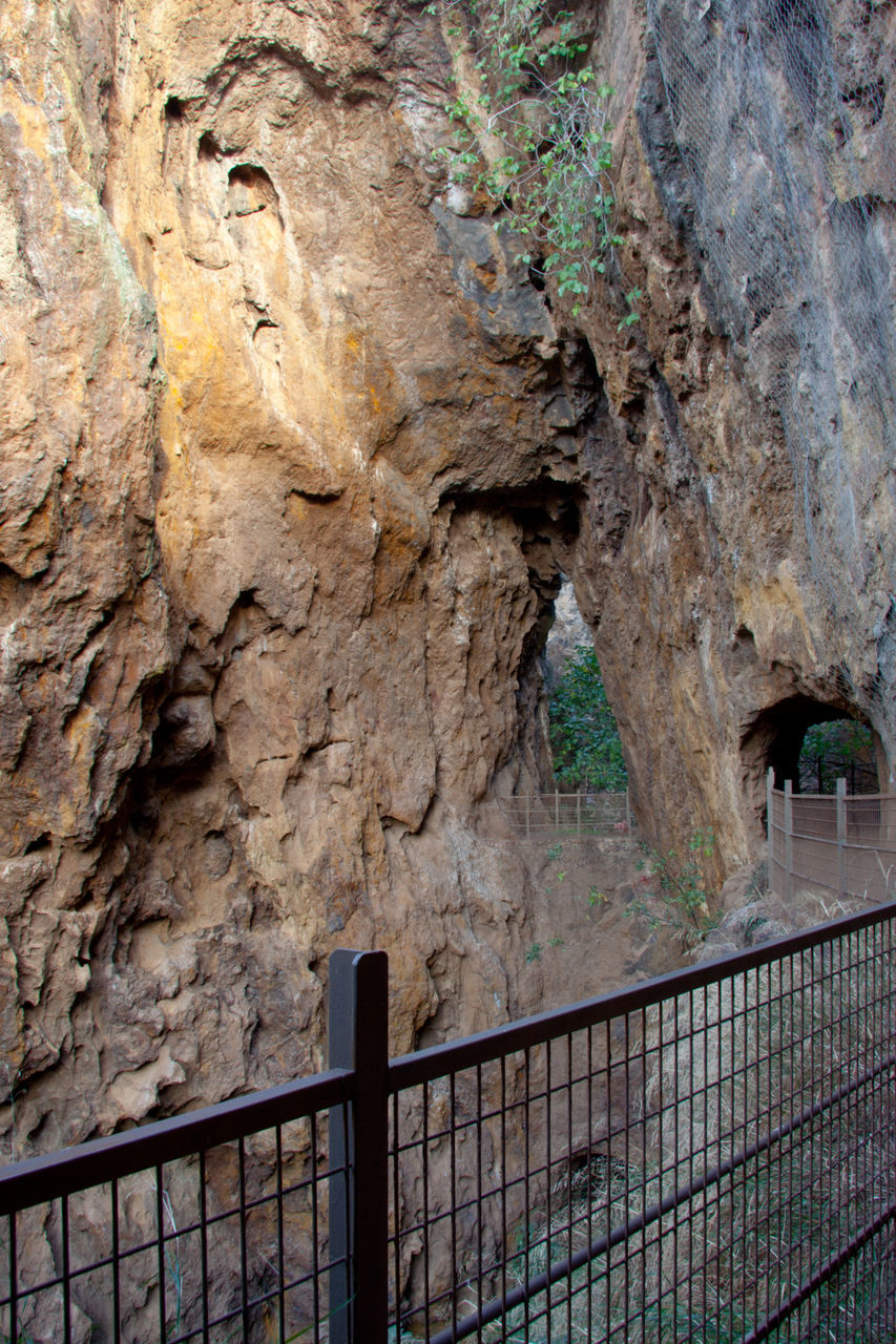 railing, rock - object, nature, no people, day, outdoors, beauty in nature, tree, close-up, prison