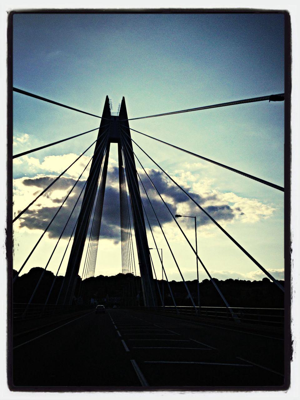 connection, bridge - man made structure, transportation, sky, suspension bridge, day, architecture, built structure, no people, outdoors, bridge, cable, city, line