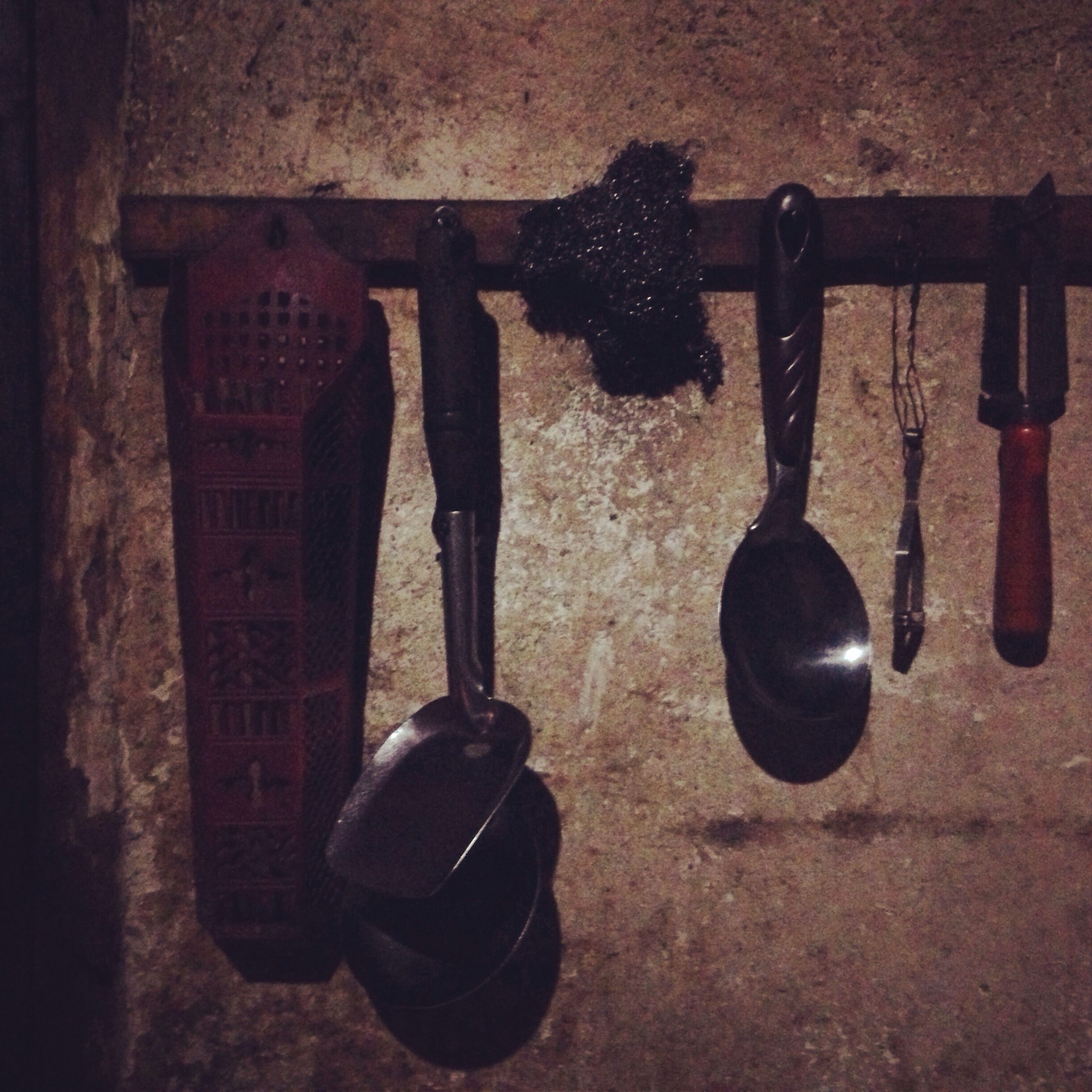 still life, high angle view, indoors, close-up, table, metal, large group of objects, equipment, variation, no people, shadow, group of objects, hanging, day, metallic, medium group of objects, wood - material, arrangement, absence, side by side