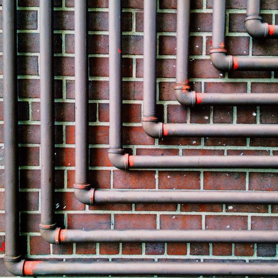 Pipes on a wall in the East Village. Precision Precision BCG IPhoneography IPSPatterns