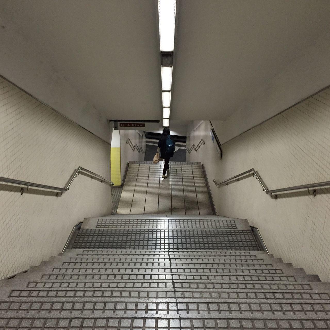 Woman Walking In Illuminated Subway