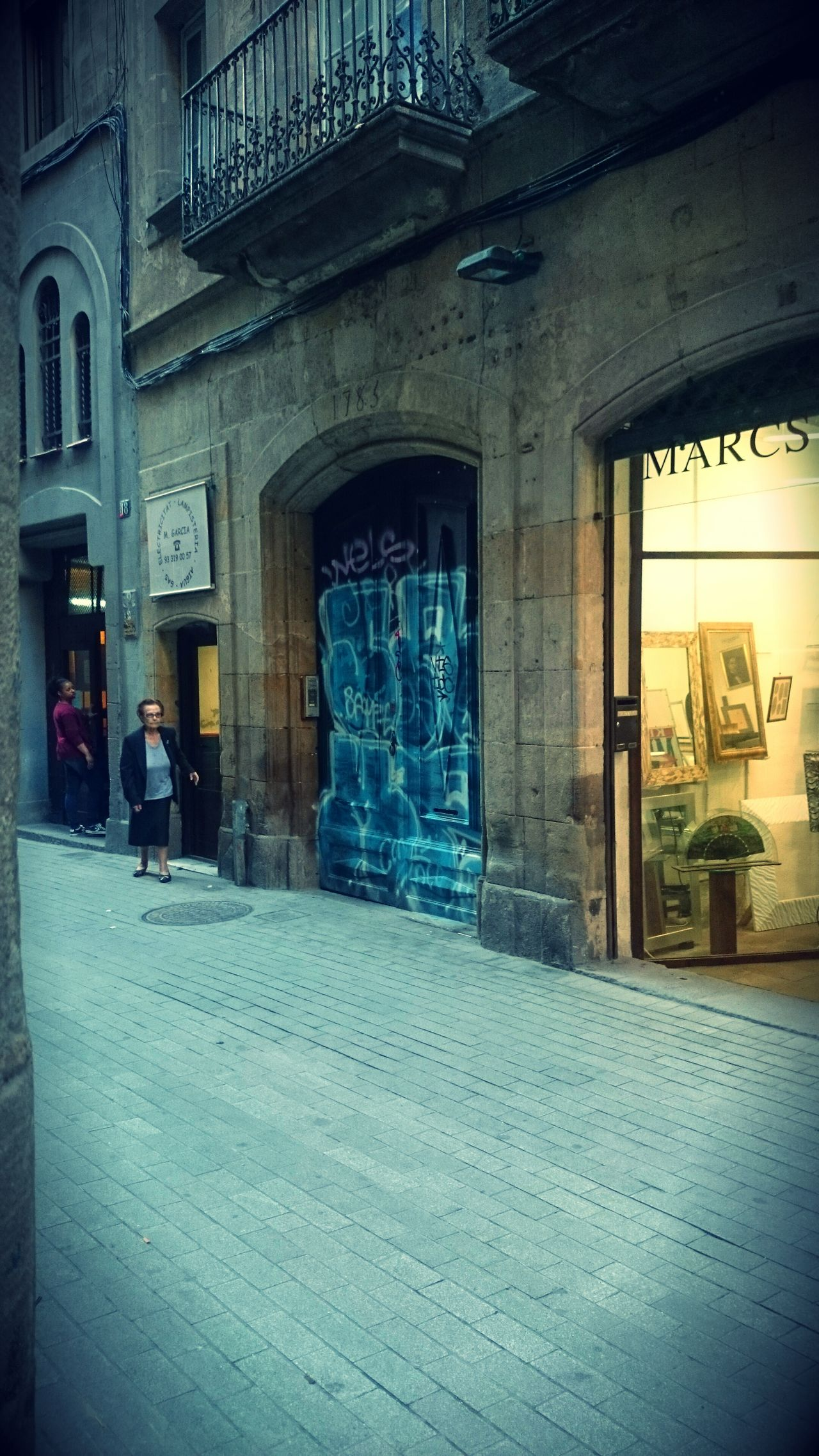 Barcelona, barri gotic, sant pere mes baix Window Built Structure Architecture Real People Day Men One Person Indoors  People Tourism House Architecture Building Exterior City Door History Barcelona Neighborhood