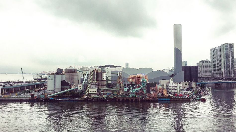 Tokyo Harbour through a train window Tokyo Japan Industrial Harbour Photography Photooftheday Ocean Water Sky Architecture City Built Structure IPhoneography Eye4photography  Hello World Taking Photos Rainy Days Melancholy Sea ASIA Traveling Exploring