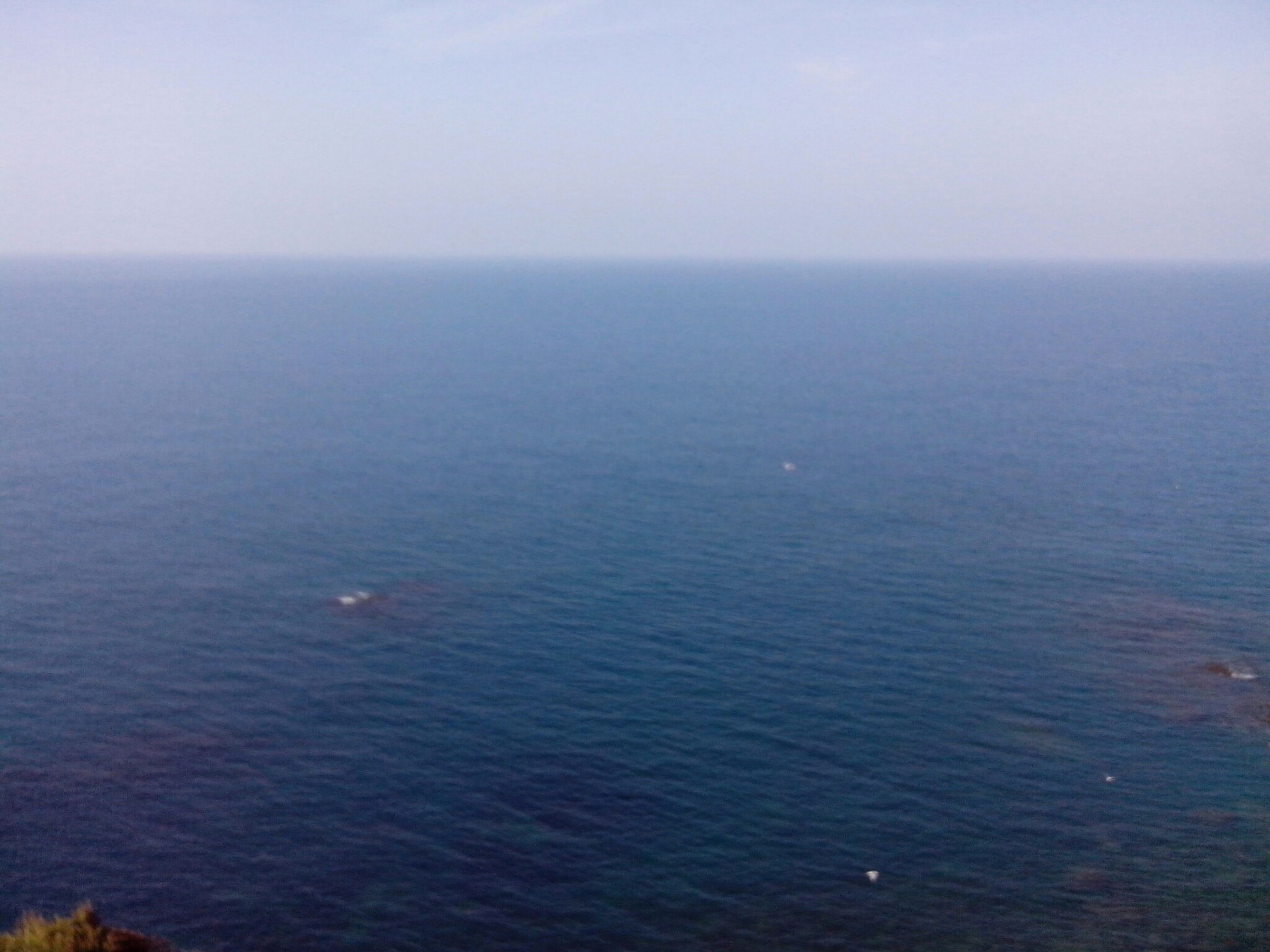 sea, horizon over water, water, tranquil scene, tranquility, scenics, beauty in nature, copy space, clear sky, nature, seascape, waterfront, idyllic, sky, rippled, blue, remote, calm, ocean, outdoors