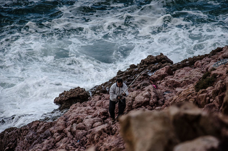 Atlantic Ocean Beauty In Nature Cat Day Fish Fisherman Idyllic Macro Marocco Motion Nature Non-urban Scene Outdoors Remote Rock Rock - Object Rock Formation Shore SP Sport Tranquil Scene Water Wave The Great Outdoors - 2016 EyeEm Awards