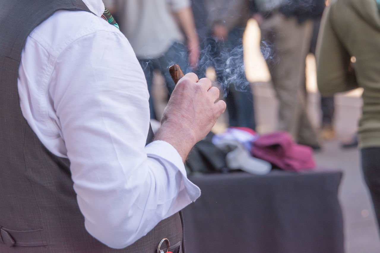 Cigars Close-up Day Holding Human Body Part Human Hand Lifestyles Men Midsection One Person Outdoors People Real People Well-dressed