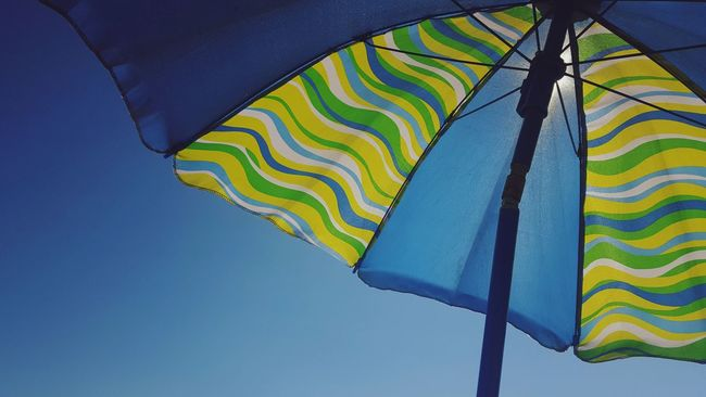 On The Road Day Travel Outdoors Perspective Sky Sun Water Amateurphotography Beach Colors Colorful Shade Unbrella Pattern