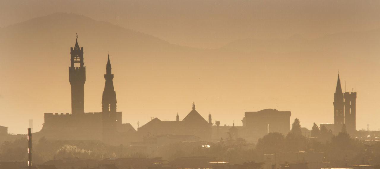 Silhouette cityscape in fog